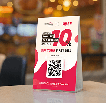 Flex Rewards QR-coded table display for Machan's Kitchen showing a 10% Discount as a Welcome Reward upon Joining