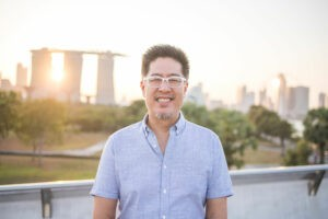 simon cheong in singapore with marina bay sands in the background
