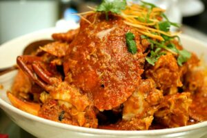 singapore chilli crab in a bowl with garnish
