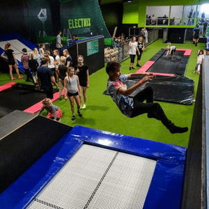 boy jumping off a wall at indoor trampoline park