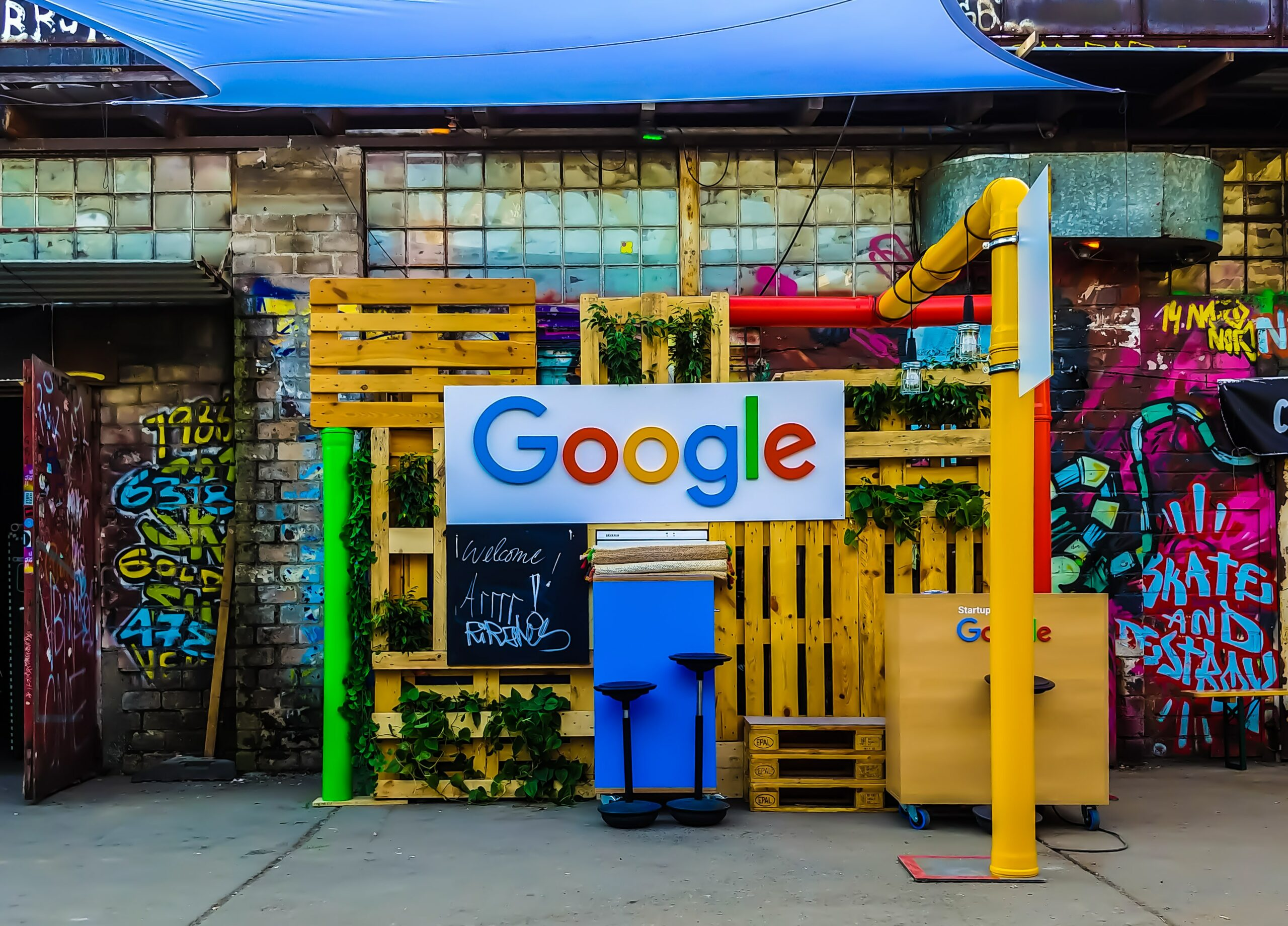 Google Logo in Street Pop Up With Graffiti and Pipes in the Background