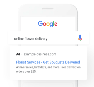 Sample Google Search Ad Displayed Over White Phone with Google Logo
