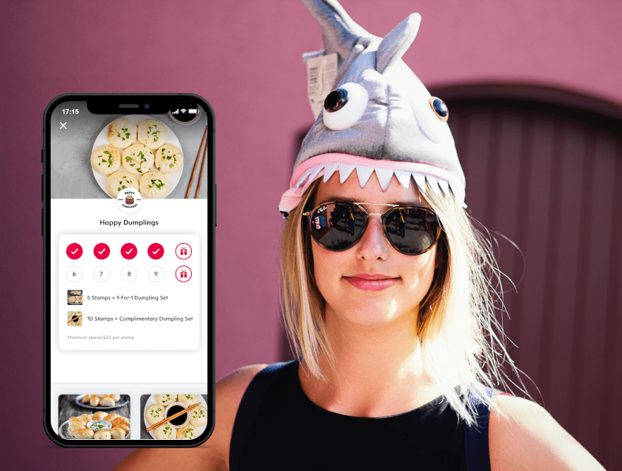Blonde Woman Wearing a Fish Hat Wearing Sunglasses and Flex Rewards Screenshot of Happy Dumplings Loyalty Reward in Foreground