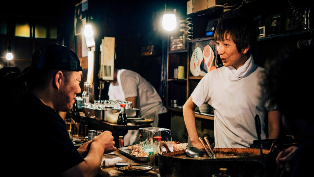 chef talking to customer in Japanese restaurant